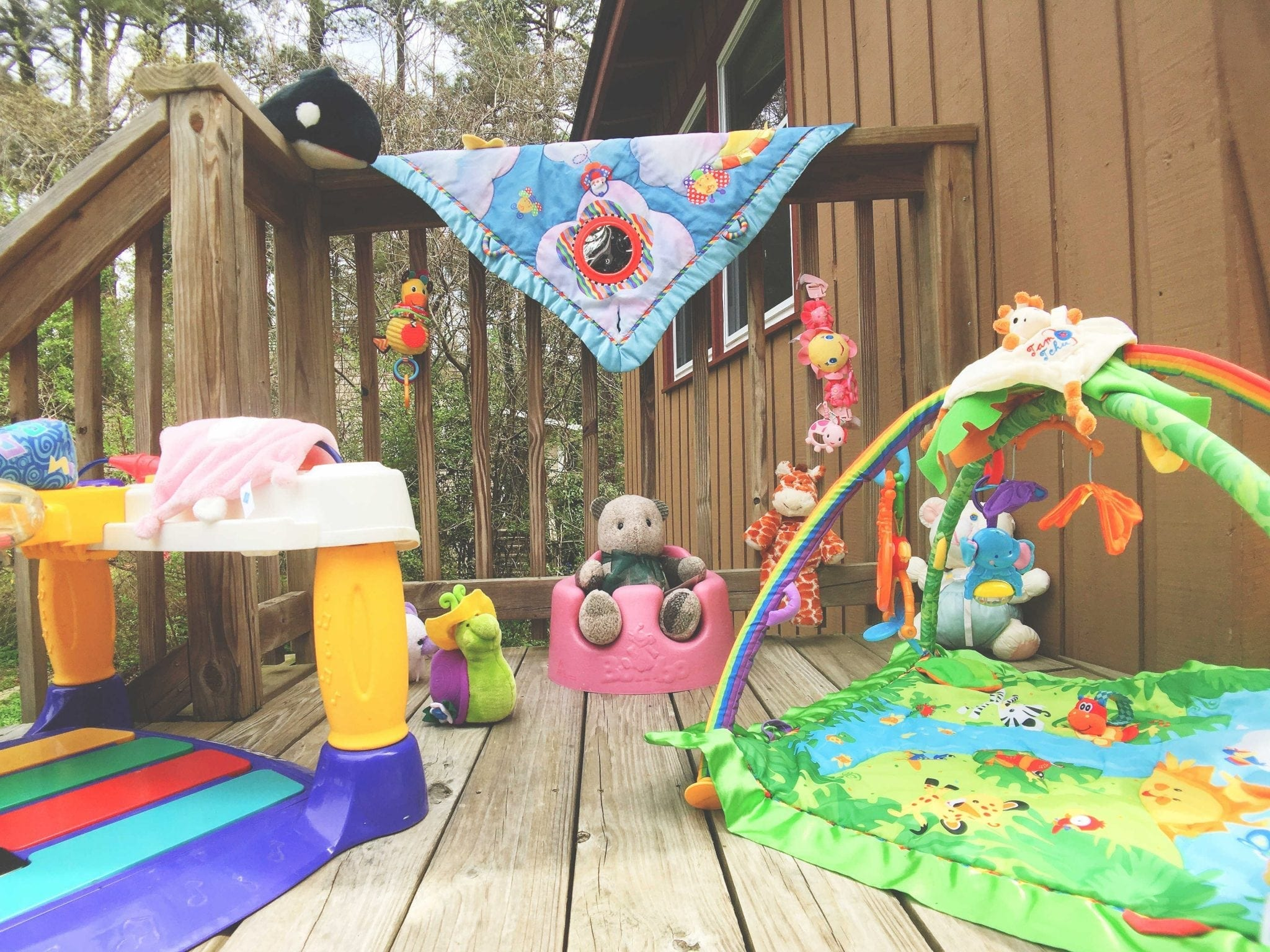 Secondhand Exersaucer, Baby Gym, Bumbo Seat, Activity Mat and so many Toys!